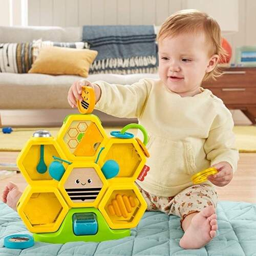El Busy Activity presenta una variedad de texturas y sonidos                              para bebés desde 1 año.